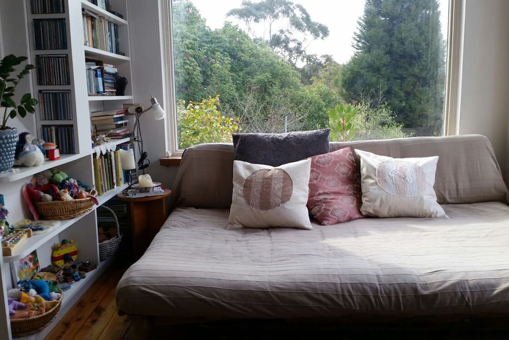 Sunroom/study with double futon daybed. A restful spot to read, daydream, contemplate or just soak up the sun all day.