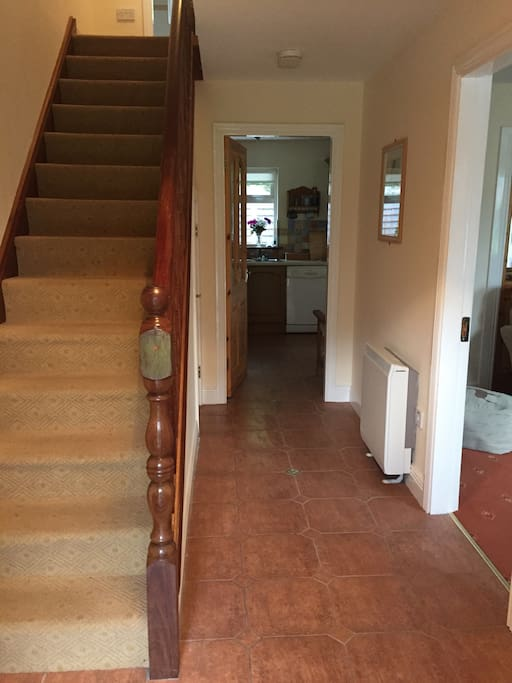 Spacious hallway with downstairs guest w.c. and whb