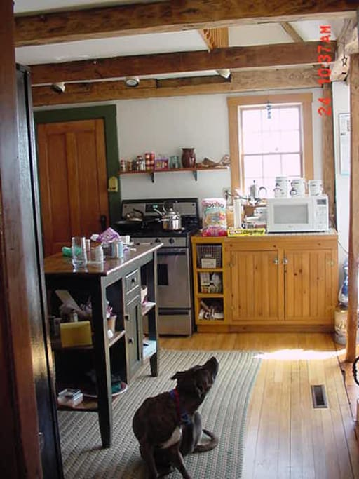 An old photo of the kitchen but currently there is no microwave or butcher's block.