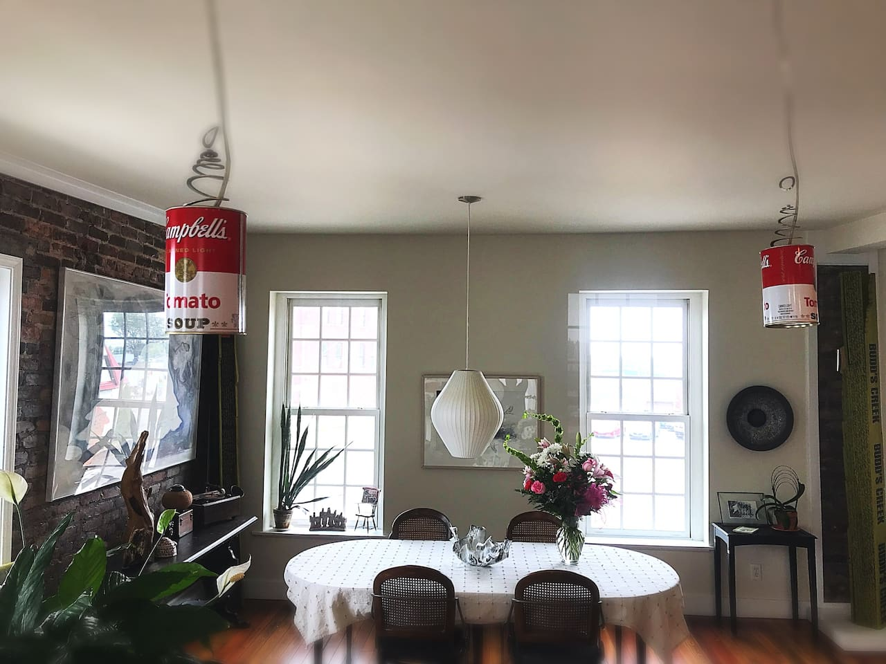 The loft is filled with original contemporary art. Andy Warhol Campbell soup cans lighting the kitchen are a playful touch.