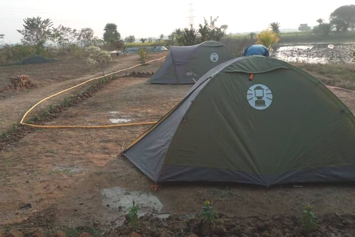 Bedroom 3 and 4- tent accomodation including floor bedding for 2-3 adults, common washroom (bath + toilet Indian) available in the farm space