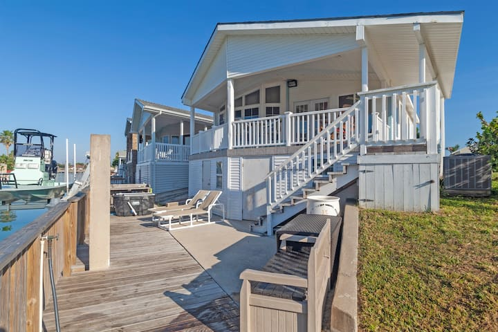 Waterfront home w/ dock, shaded deck & shared pools/hot tub/tennis/gym!
