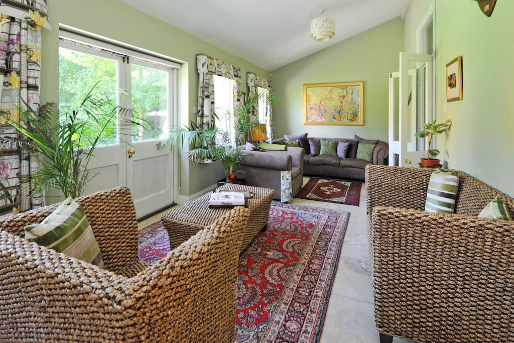 The living room has french doors opening to the garden.