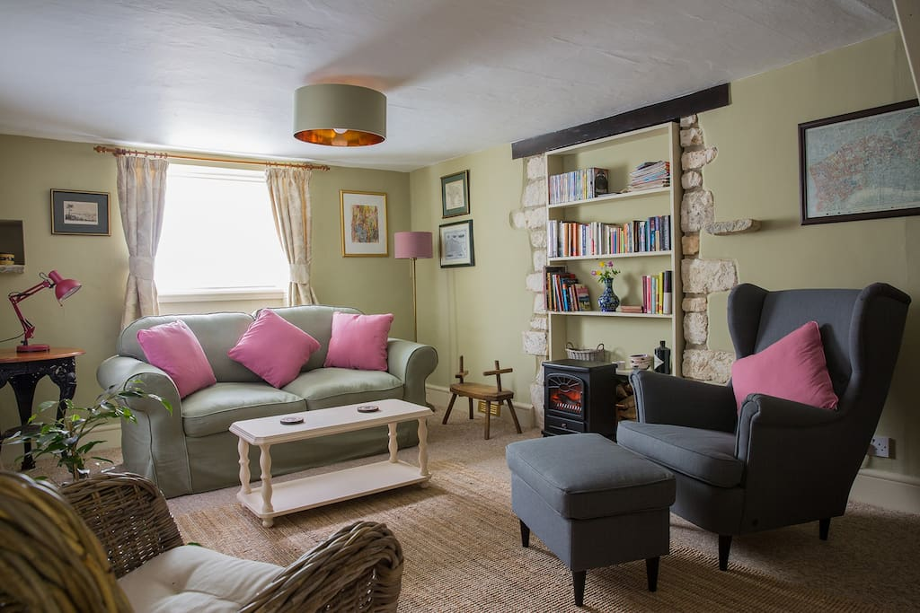 Cosy sitting room including a sofa bed with linen provided.
