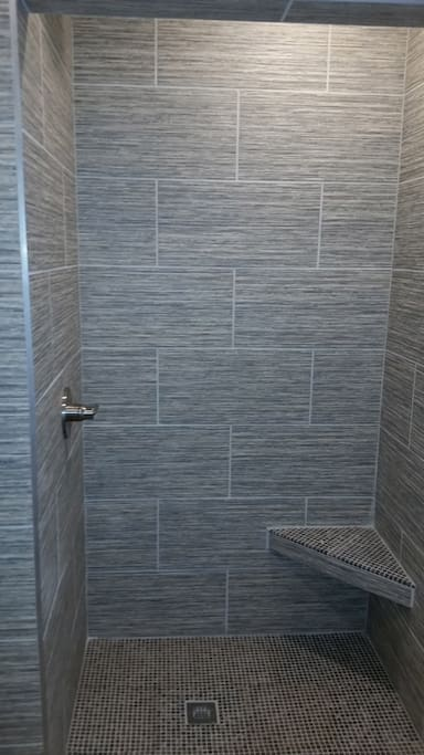 2nd bathrooms shower with tiled bench seat