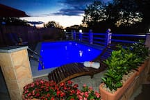 PURE HEDONISM BY THE HEATED POOL AT NIGHT
