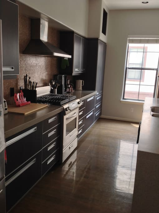 Fully equipped kitchen with dishwasher, garbage disposal, french door refrigerator with ice maker, gas range, microwave, etc