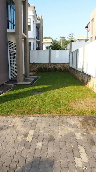 Dry area beside the garden that suitable for BBQ and family activities