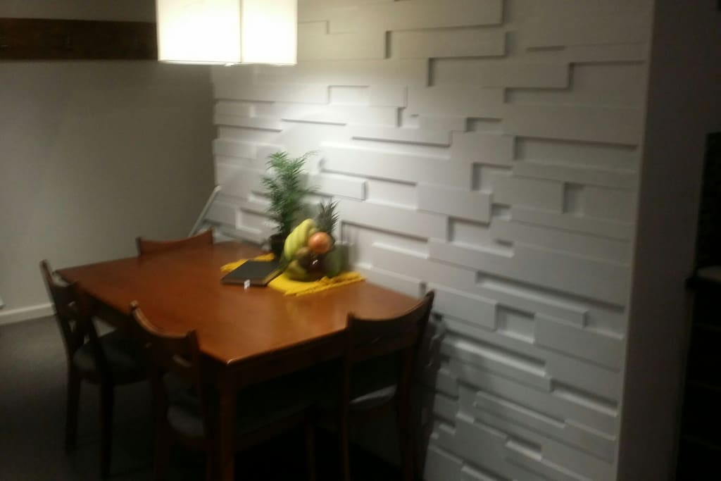 New dining room space right off the kitchen. 3D wall with an extending table for dinner parties or just more room to spread out.