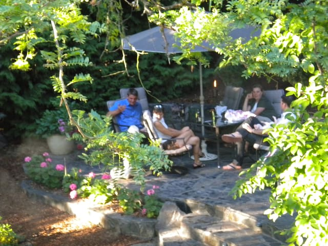 Flagstone terrace for outdoor dining and relaxing. Water feature provides soothing sounds.