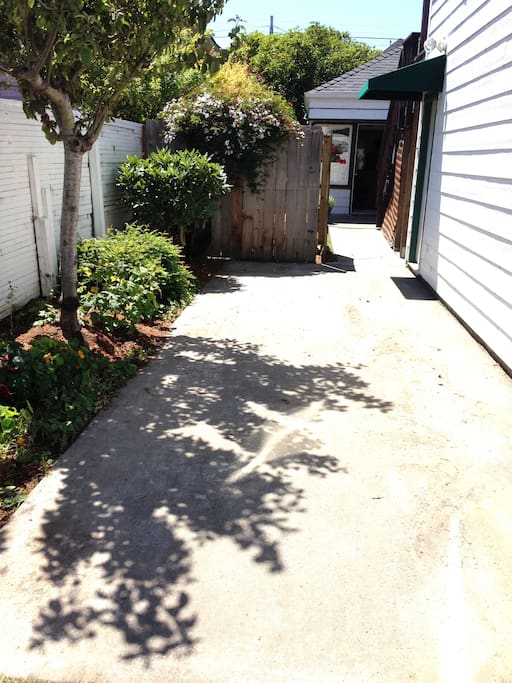 Rear parking pad with ramp into house