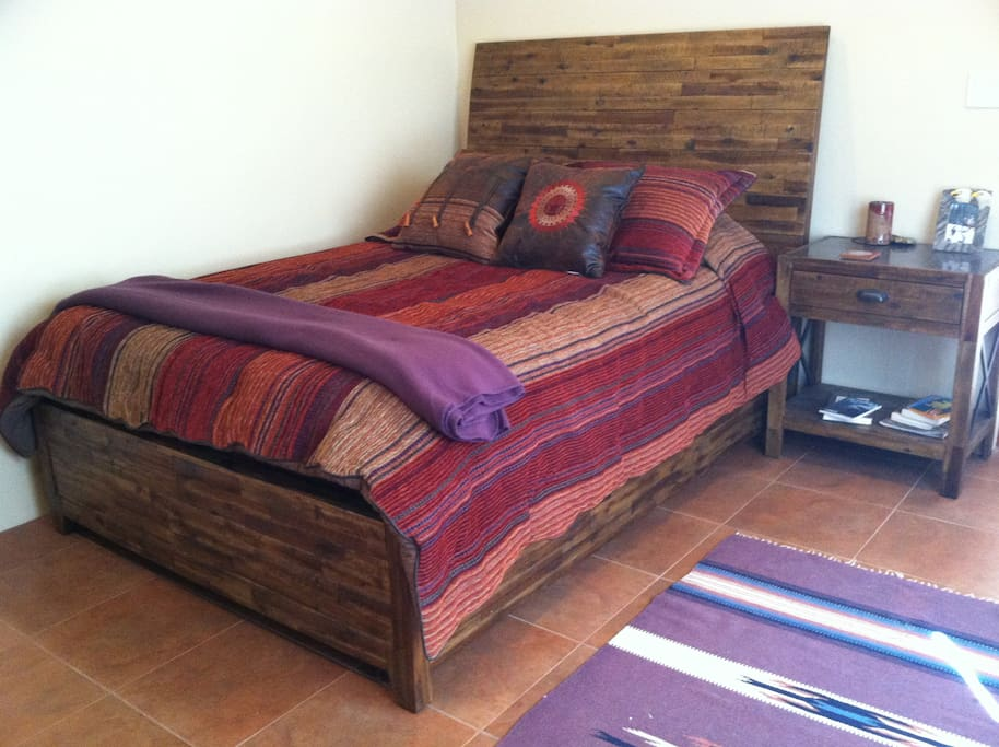 Queen memory foam bed with shared bathroom.