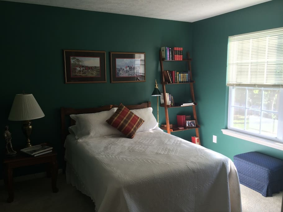Guest room with books to read and cozy atmosphere.