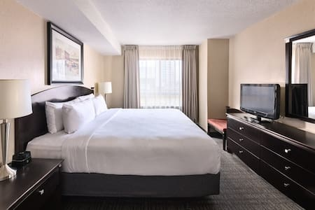 Relax in total comfort with a pillow top Queen size bed, television, plenty of space to store your belongings