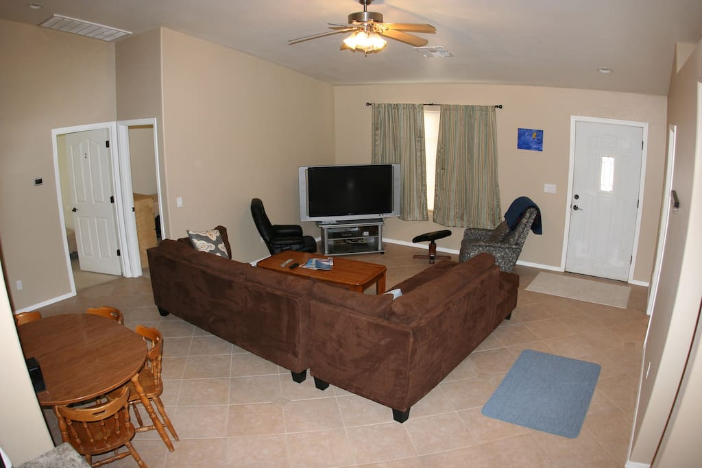 """Living room with 50"""" satellite TV"""