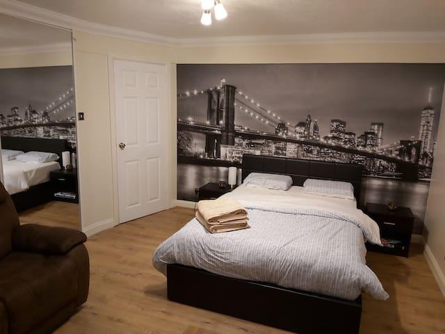 Spacious double bedroom with urban balcony