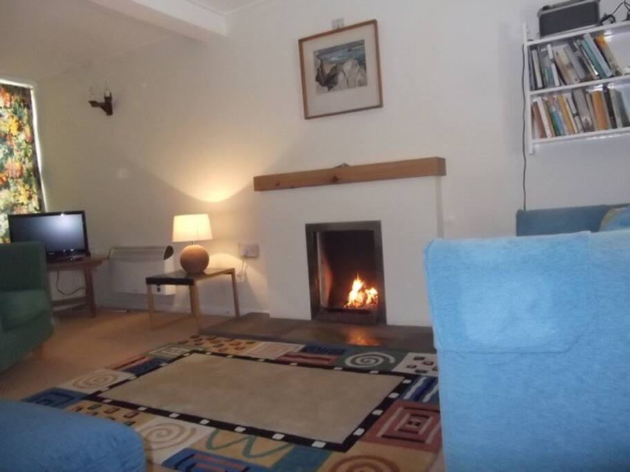 The living room overlooks  the front garden and also has fabulous views of boats sailing in the Rathlin Sound sitting in the window seat.