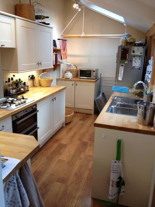 Kitchen with gas cooker, microwave, washing machine, dishwasher, juicer etc