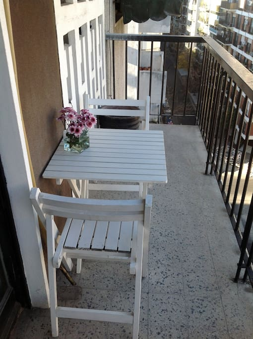 Spacious balcony with chairs and table. 5 by 1,2 metres