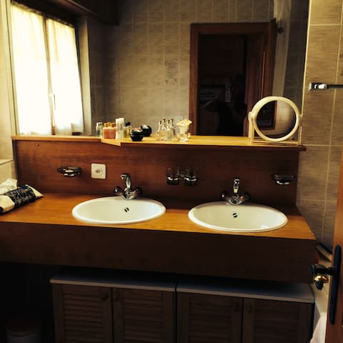 Large double bathroom with full bathtub-shower.