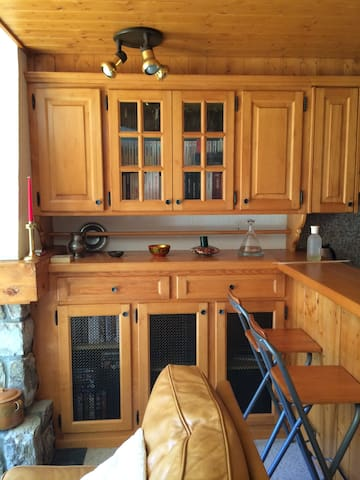 All wood cabinets with stereo system, books, games and lots of videos!