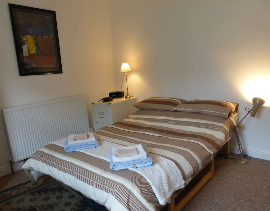 Bedroom 2 has a double bed with clock radio and hair-dryer