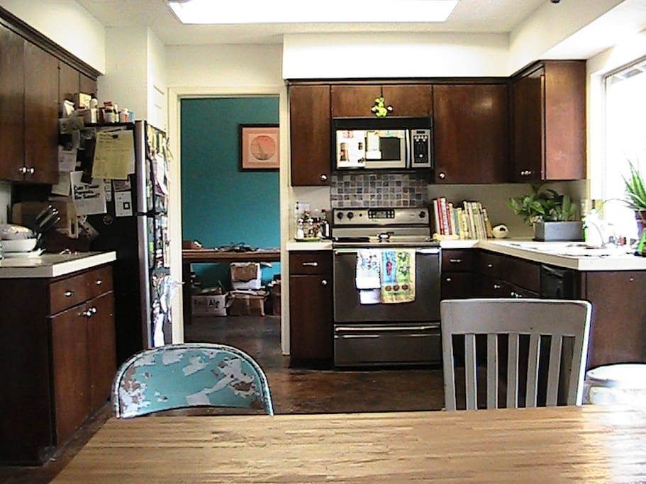 Kitchen with dining room in background.