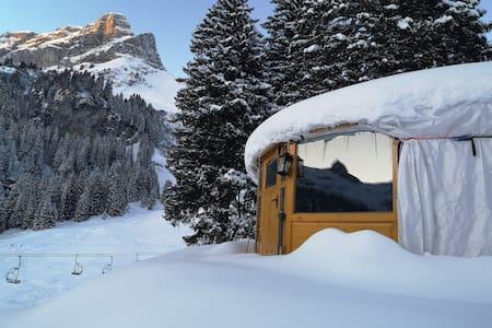Yurt in imposing mountains