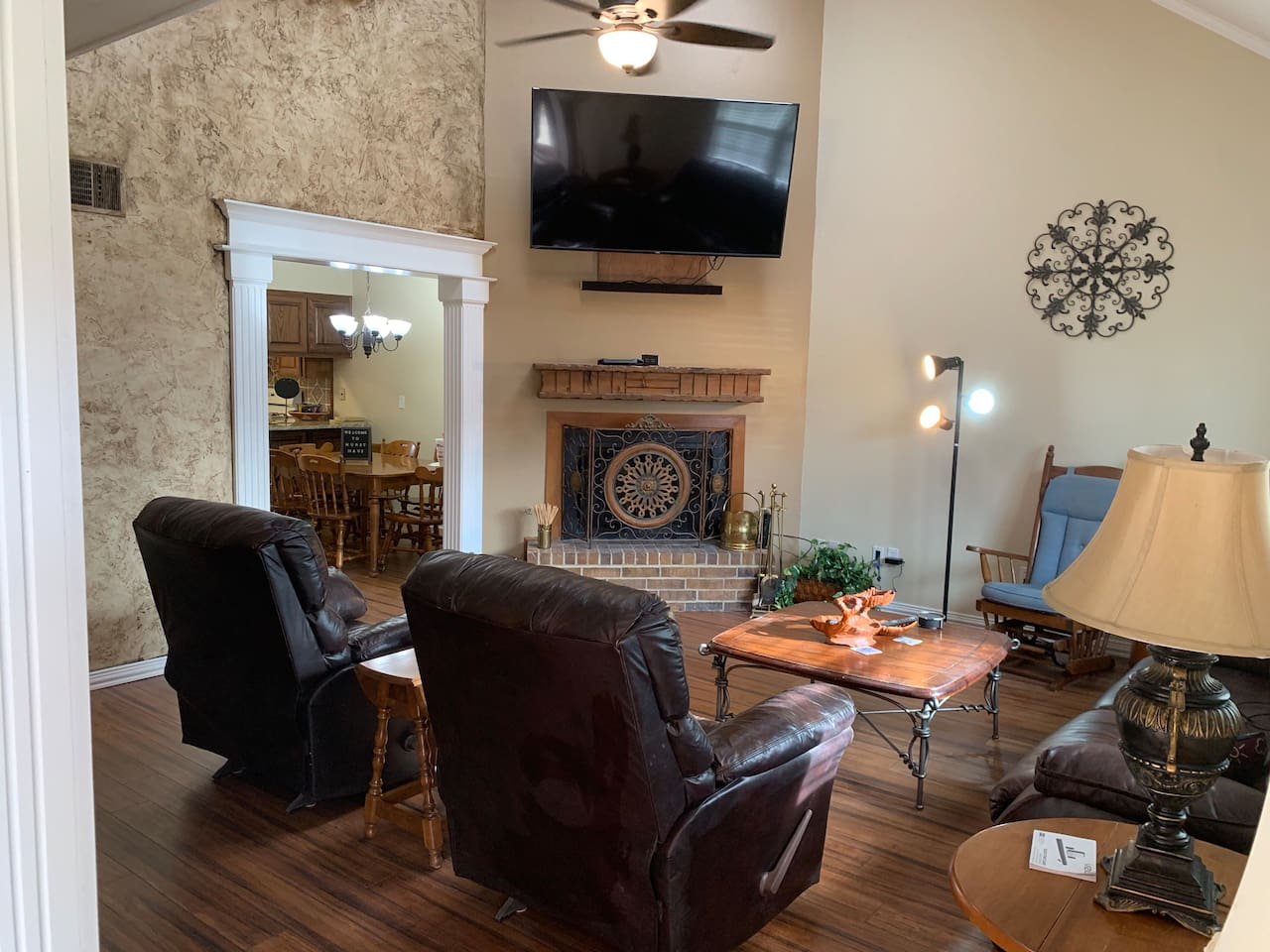 Enjoy the large screen tv while relaxing in the recliners or on the couch! Great room to just kick back and enjoy some family time!! Overhead light and ceiling fan are remote controlled!