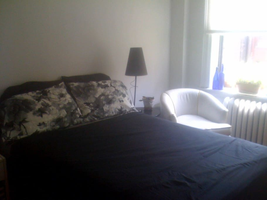 Comfy bedroom, swivel club chair, + sunny window Summer 2014