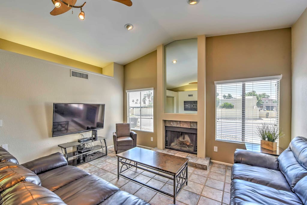 The spacious interior is renovated with a new great room, plush furnishings and large windows that provide views of the backyard.