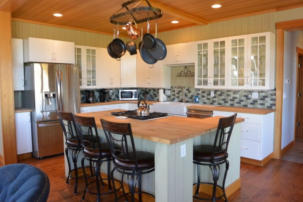 Large gourmet kitchen with gas stove and stainless appliances. Keurig and 12-cup coffee maker, fully stocked to make wonderful meals.
