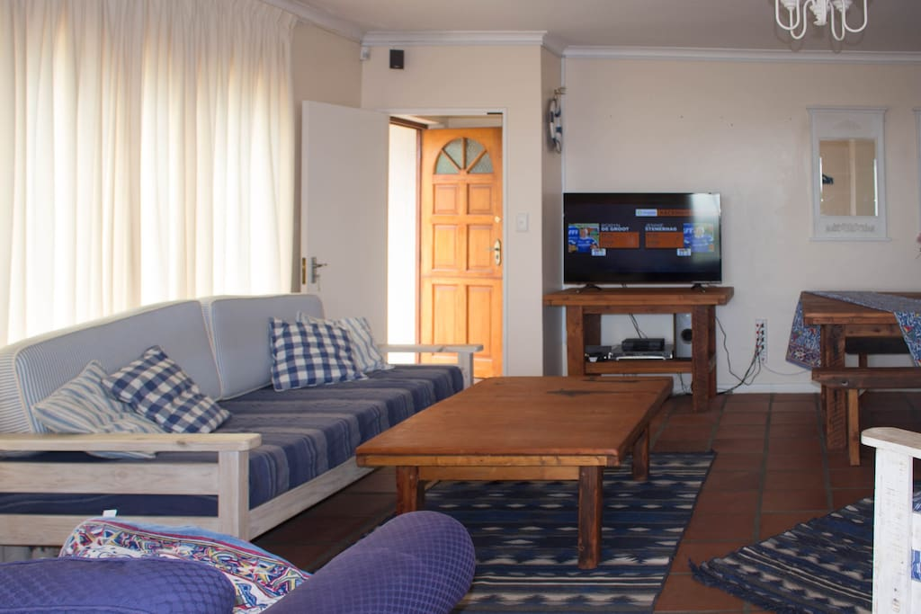 """Laid back lounge area, with DSTV, DVD, 48"""" flat screen"""