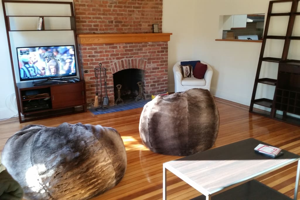 Working fireplace ... TV with cable, a DVR to record your own shows, a Blu-Ray player, and Wi-fi access. Kids and grown-ups both love the huge fuzzy beanbag chairs! Carpet since added.