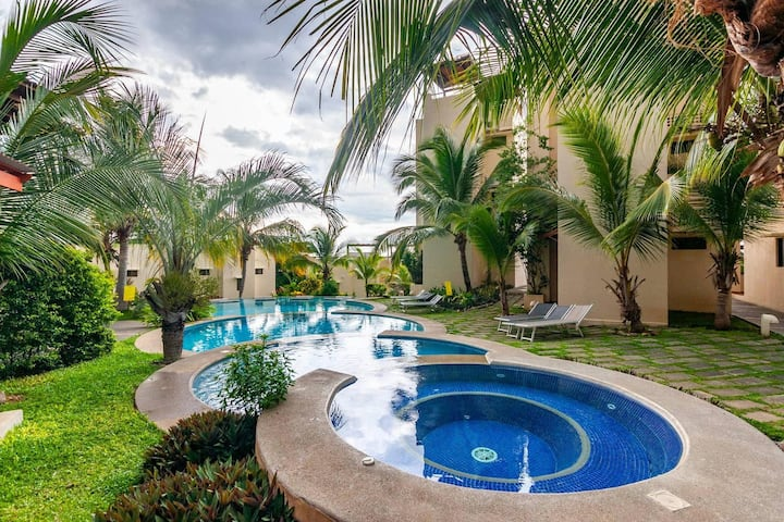 Colorful classy modern split level unit near beach in Coco with pool
