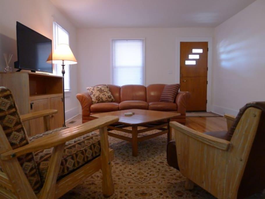 living room with vintage western furniture