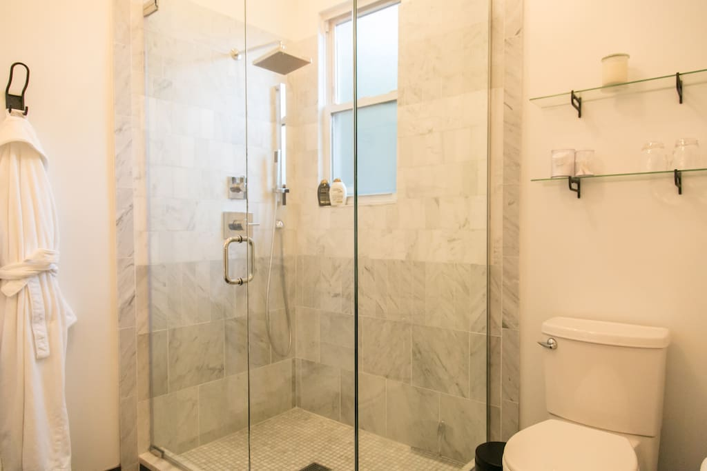 Spa like Marble bathroom, large walk-in shower. We provide plush robes, all your towels and soaps.
