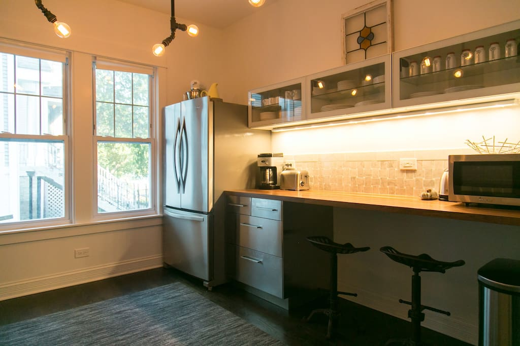 Fully stocked gourmet kitchen with breakfast and snacks for you.