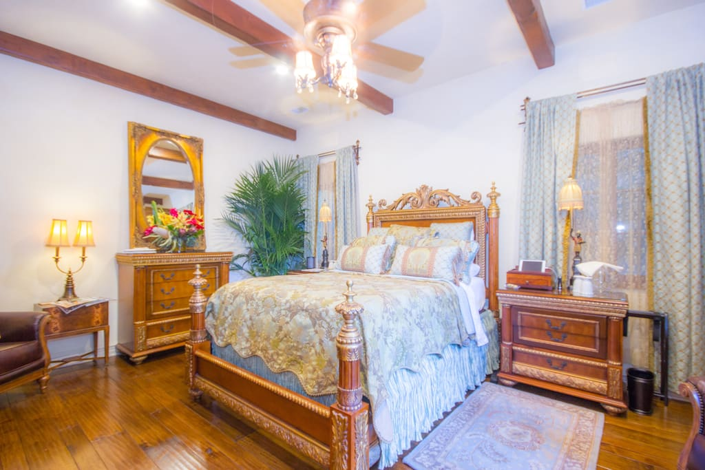 Queen size bed suite is appointed with custom Neiman Marcus furnishings