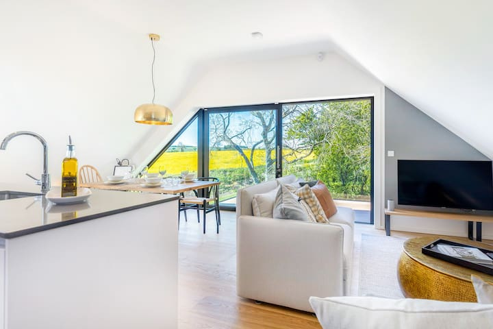 From the dining terrace, The Loft looks out on to its own private pond and rolling countryside