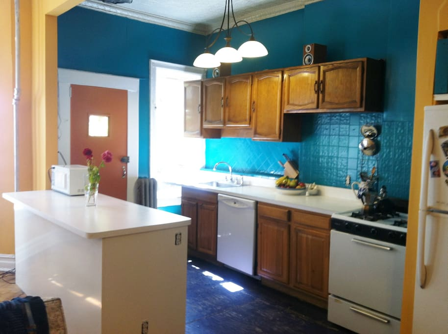 Spacious, bright kitchen with peninsula. Dishwasher, microwave, full size refrigerator.