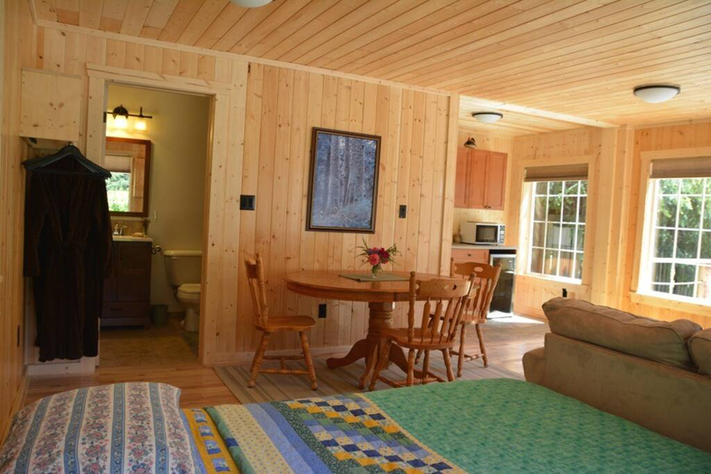 Pine walls and wood floor, wood table and chairs for enjoying the breakfast baskets