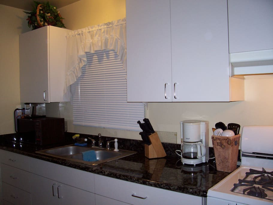 This is a fully furnished kitchen with just about everything but your food.