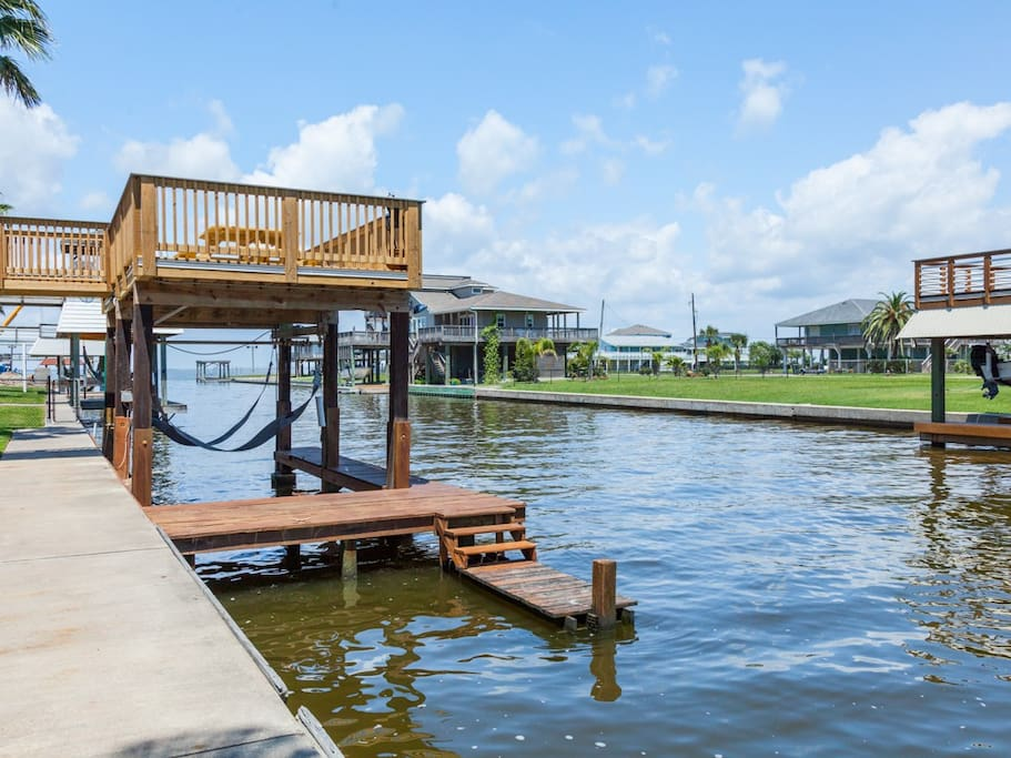 Dip your toes in the water from home's private dock.