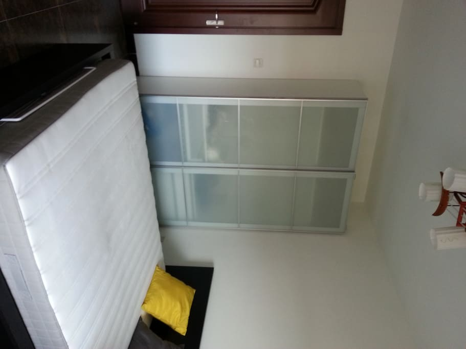 bedroom with spacious Ikea wardrobe to keep your clothes and ties in decent way