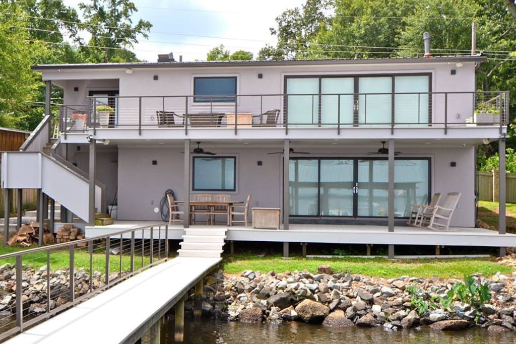 two deck levels face lake, lower has outdoor shower with hot/cold water