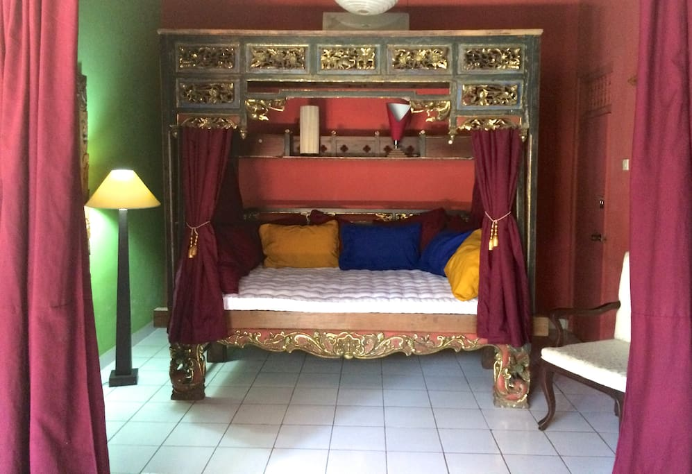 The second bedroom has an antique Indonesian bed (and air conditioning).