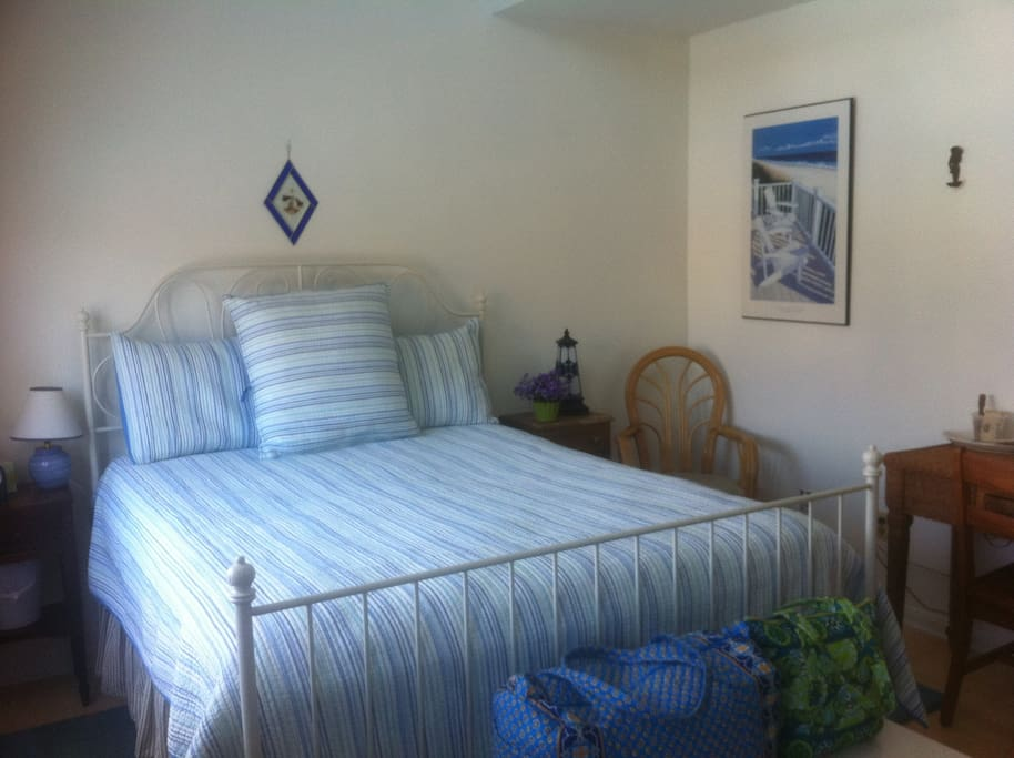 Master Bedroom with flat screen TV and comfortable queen size bed!