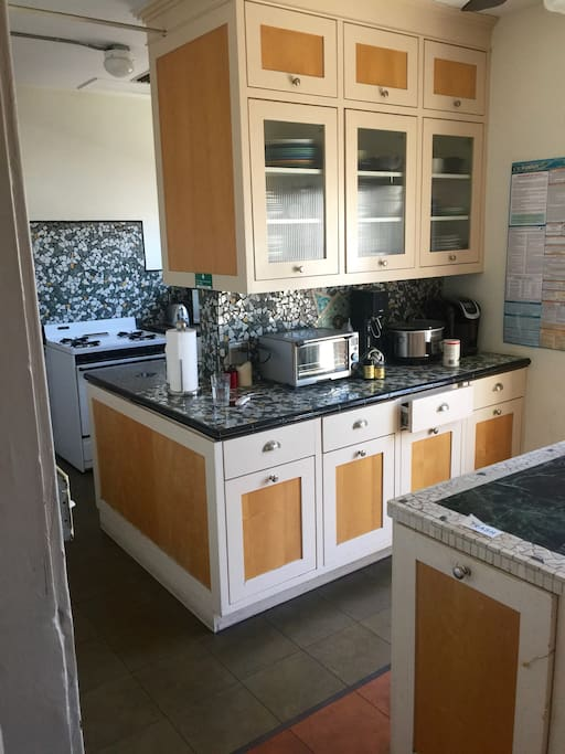 Shared kitchen equipped with a fridge, stove, dry food storage, appliances and utensils for your use.