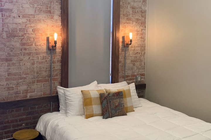 Comfy King Bed with sconce lighting